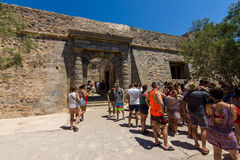 Tourists on Spinalonga island and fortress of the same name. CRETE, GREECE - JULY 11, 2016: Tourists on Spinalonga island and fortress of the same name royalty free stock photo