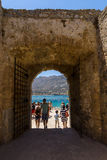 Tourists on Spinalonga island and fortress of the same name. CRETE, GREECE - JULY 11, 2016: Tourists on Spinalonga island and fortress of the same name royalty free stock photos