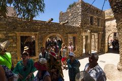 Tourists on Spinalonga island and fortress of the same name. CRETE, GREECE - JULY 11, 2016: Tourists on Spinalonga island and fortress of the same name stock image