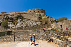 Tourists on Spinalonga island and fortress of the same name. CRETE, GREECE - JULY 11, 2016: Tourists on Spinalonga island and fortress of the same name. View stock photography