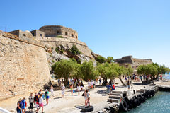 The tourists are on Spinalonga island Royalty Free Stock Photos