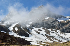 Tourists on the spring slope in the cirque Troumouse Royalty Free Stock Photo