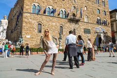 Tourists on the square in front of the Palazzo Vecchio. Florence Royalty Free Stock Photography
