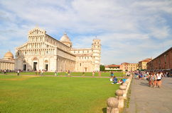 Tourists on Square of Miracles visiting Leaning Tower in Pisa, Italy Stock Photo