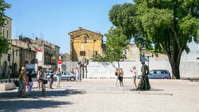 Tourists on square Place des Arenes in Nimes Royalty Free Stock Images