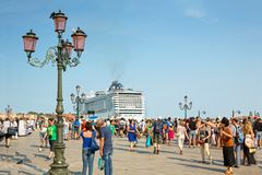 Tourists at St. Mark's Square in Venice, and cruise ship MSC Preziosa Royalty Free Stock Photography