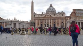 Tourists in St. Peter`s Square in the Vatican. Rome, Italy - March 22, 2018: Tourists in St. Peter`s Square in the Vatican stock video footage