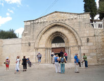 Tourists stand at an entrance to church of the Dormition of the Royalty Free Stock Photos