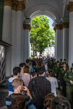 Tourists stand in queue long hours in the State Hermitage Museum Royalty Free Stock Image