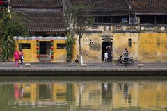 Tourists standing along waterfront in colourful old quarter, Hoi An royalty free stock photos