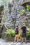 Tourists standing at the aviary with mountain goats Royalty Free Stock Photos