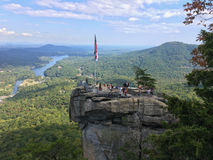 Tourists standing on Chimney Rock Stock Images