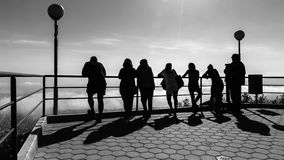 Tourists standing on the observation deck visiting the panorama of the city from the top of the mountain Royalty Free Stock Images