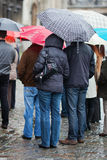 Tourists standing in the rain Royalty Free Stock Image