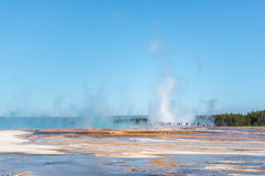Tourists standing in the steam of Grand Prismatic hot spring stock photo