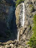 Tourists standing submontane of the lower Yosemite waterfall Royalty Free Stock Photos