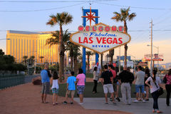 Tourists standing by Welcome to Fabulous Las Vegas sign, Nevada Stock Images