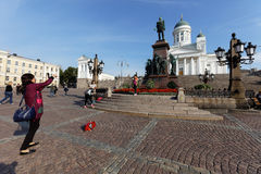 Tourists at the statue of Alexander II in Helsinki, Finland Royalty Free Stock Photography