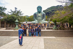 Tourists at statue of The Great Buddha of Kamakura, Japan Royalty Free Stock Image