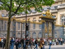 Tourists stay in queue in front of Palais de Justice. PARIS, FRANCE - MAY 29, 2006: Tourists stay in queue in front of Palais de Justice on May 29, 2006 in Paris Royalty Free Stock Photos