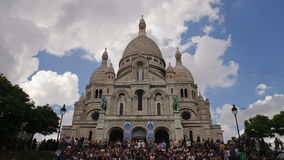 Tourists on the steps of basilique du sacre coeur in paris france with blue stock video