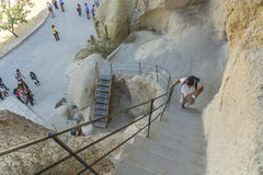 Tourists  on the steps in goreme museum. Stock Image