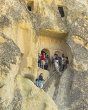 Tourists on the steps in goreme museum. Royalty Free Stock Image