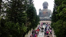 Tourists on the steps to the statue Tian Tan Buddha. HONG KONG, LANTAU ISLAND, 06 DEC 2015, Tourists on the steps to the statue Tian Tan Buddha stock video footage