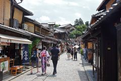 Tourists in the stone-paved roads of Ninenzaka and Sannenzaka in Kyoto. royalty free stock photography