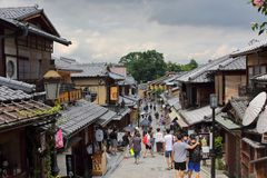 Tourists in the stone-paved roads of Ninenzaka and Sannenzaka in Kyoto. Kyoto, Japan-August, 11th of 2017:Tourists in the stone-paved roads Ninenzaka and Royalty Free Stock Images