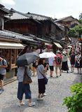 Tourists in the stone-paved roads of Ninenzaka and Sannenzaka in Kyoto. Kyoto, Japan-August, 11th of 2017:Tourists in the stone-paved roads Ninenzaka and Royalty Free Stock Photos