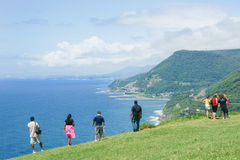 Tourists stop to take in view and the distant Sea Cliff Bridge a Royalty Free Stock Images