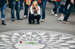 Tourists at the Strawberry Field in Manhattan. Stock Photo