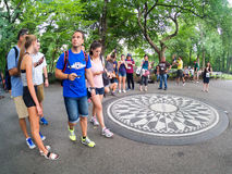 Tourists at Strawberry Fields in Central Park in New York Stock Image