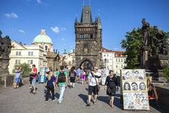 Tourists, street artists and vendors on Charles Bridge, Prague. Royalty Free Stock Photo