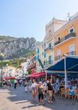 Tourists at Street cafes in Capri Island. Capri, Italy - October 3, 2017: Tourists at Street cafes in Capri Island, Italy royalty free stock image