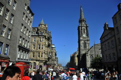 Tourists on the street of Edinburgh. Edinburgh is a famous tourism city in UK, this photo shows many tourists are walking on a street in Edinburgh stock photo