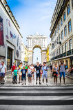 Tourists on the Street in Lisbon. Tourists standing in the Baixa district in Lisbon Portugal royalty free stock image