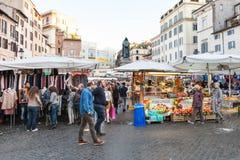 Tourists on street market on square Campo de Fiori Stock Photos