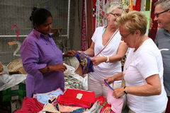 Tourists Street Market - Women buying underwear Royalty Free Stock Photography