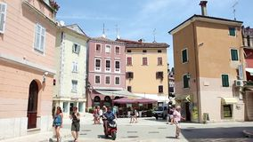 Tourists on street in Rovinj stock video footage
