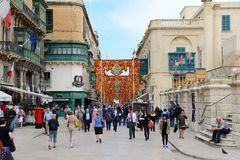 The tourists are on the street of Vallettta. VALLETTA, MALTA - APRIL 21: The tourists are on the street of Vallettta on April 21, 2015 in Valletta, Malta. More Royalty Free Stock Photos