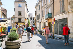 Tourists on street and view of Arenes d`Arles Stock Image