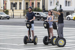 Tourists on the streets of Budapest excursion to Segway. BUDAPEST, HUNGARY. 23 JUNE, 2017:Tourists on the streets of Budapest excursion to Segway Royalty Free Stock Photos