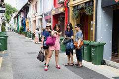 Tourists in streets of the Kampong Glam. SINGAPORE - CIRCA FEBRUARY, 2015: Tourists in streets of the Arab quarter (Kampong Glam) do self. Arab Quarter is the Stock Photography