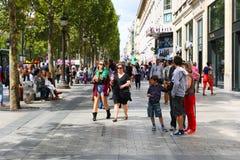 Tourists stroll at Champs-elysees - Paris. PARIS, Aug. 22 2014 : Local and tourists stroll at des Champs-elysees Avenue des Champs Elysees is the biggest and stock photos