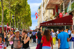 Tourists stroll at Champs-elysees - Paris Stock Images