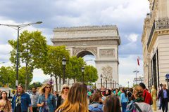 Tourists stroll at Champs-elysees - Paris. PARIS, Aug. 22 2014 : Local and tourisrs stroll at des Champs-elysees Avenue des Champs Elysees is the biggest and stock images