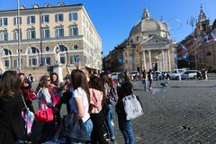 Tourists stroll at historical places at Rome royalty free stock photo