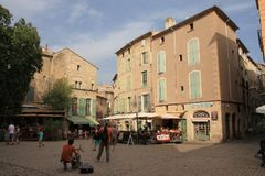 Tourists strolling in the central square of the french city of Pezenas, France. Tourists strolling in the central square of the french city of Pezenas, Herault stock images